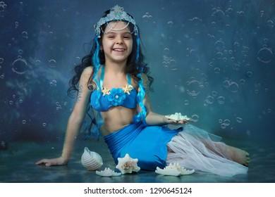 Girl of six years in a mermaid costume