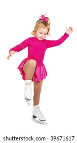The girl skates on a white background. Very happy child in purple plum dress.  She making practice on the floor.