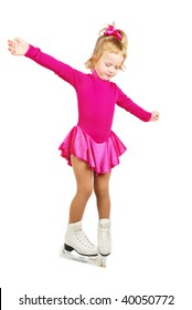The girl skates in profile on a white background. Very happy child in purple plum dress.