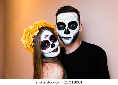 girl skeleton. Sugar skull. a dead bride. The girl in a beautiful floral wreath. Pink flowers peonies hair ornament. halloween holiday costume. black contact lenses. costume party halloween