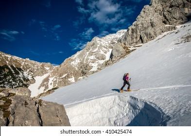 Girl ski touring in mountains