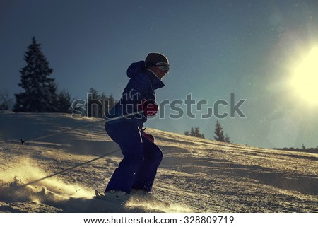 Girl skier slade down
