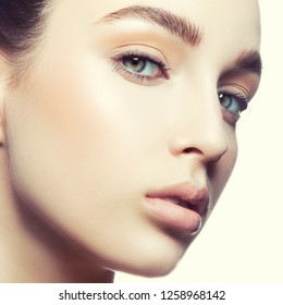 Girl skin, clean face close-up, blue eyes, natural lips, nude make-up