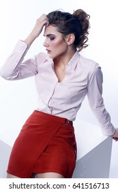 A girl in a skirt and a white shirt.Fashion photo