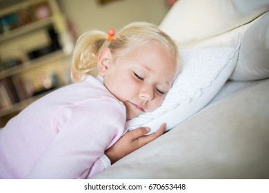 Girl sleeping in the bedroom at home