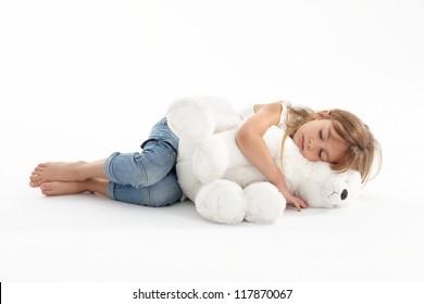 Girl sleeping with big teddy