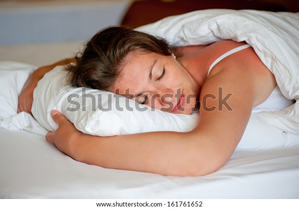 girl sleeping in a comfortable position on the stomach