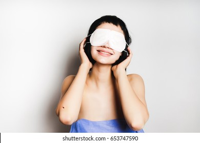 Girl with sleeping mask on her face