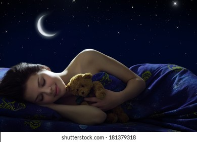 Girl sleeping at night on background of the moon