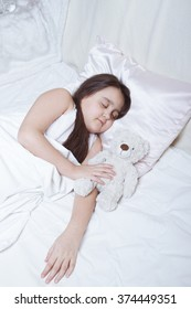 Girl sleeping on the side next to the toy