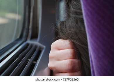 Girl Sleeping On The Train By Window During Travel, Passenger Rests On The Trip