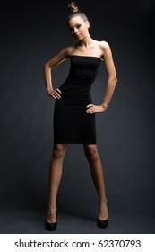 a girl in slinky black dress