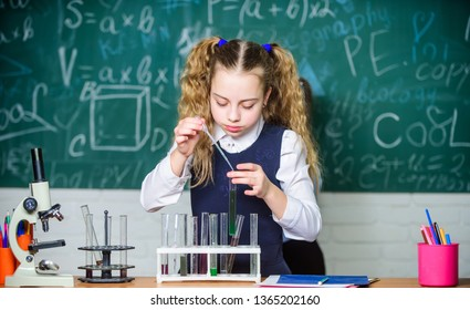 Girl smart student conduct school experiment. School pupil study chemical liquids. School chemistry lesson. Test tubes with substances. Future microbiologist. Laboratory glassware. School laboratory.