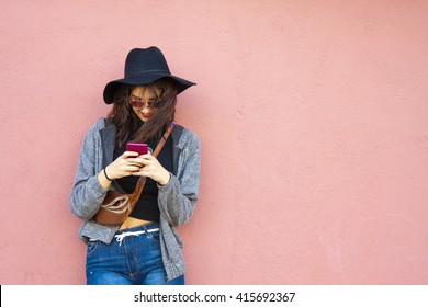 girl with smartphone on street