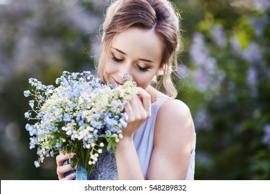 girl smelling a lily of the valley