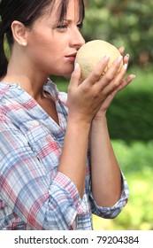 Girl smelling melon