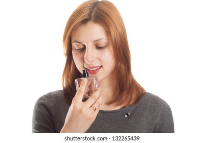 girl smelling perfume on a white background isolated