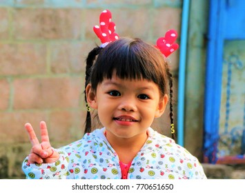 The girl smiled happily at Christmas.