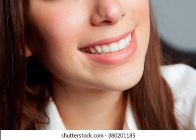 Girl smiling with beautiful white teeth