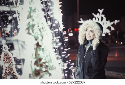 Girl smiling with a cristmas tree