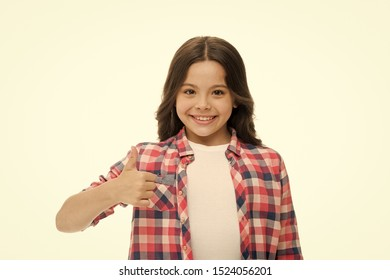 Girl smiling face feels confident. Child confidently showing thumbs up. Upbringing confidence concept. Feel so confident with parental support. I like it. Kid girl long curly hair posing confidently.