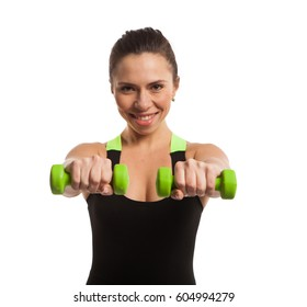 Girl smiling and posing with green dumbbells isolated