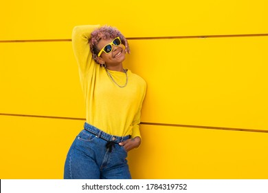 girl smiling with sunglasses on the street
