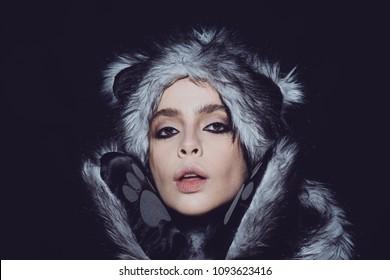 3f5b61d24e9 Girl with smokey eyes make-up wearing faux fur animal hat
