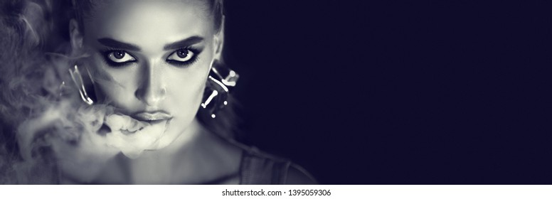 Girl Smoking E-Cigarette. Black and white portrait of woman looking at camera, copy space