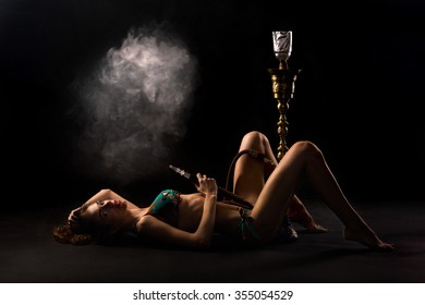 Girl smoking a hookah.