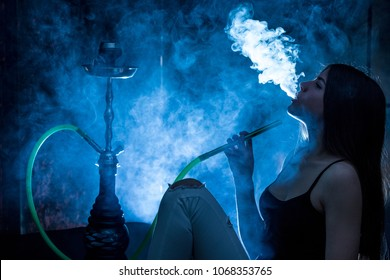 girl smoking hookah blue background