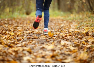 Girl in sneakers running autumn
