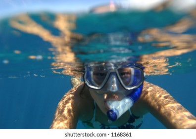 girl snorkeling in hawaii