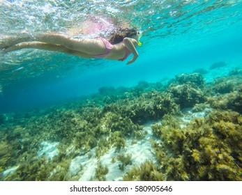Girl snorkeling in the Mediterranean sea - Blue Lagoon - Gozo - Malta