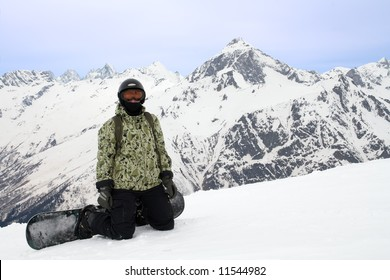 Girl with snowboard over sky and mountains
