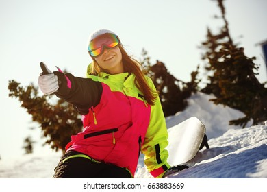 Girl snowboarder enjoys the ski resort. Sheregesh. Russia.