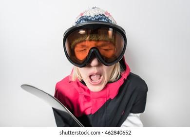 girl snowboarder rides