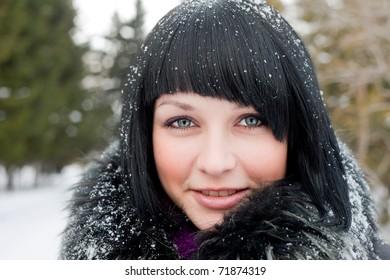 girl in snowflake look at camera smiling