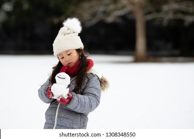 Girl with a snowman