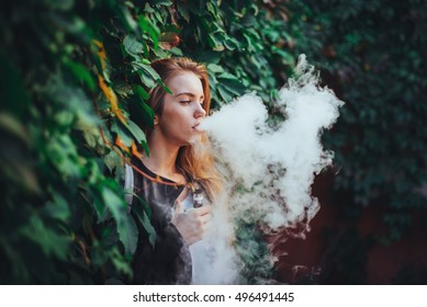 The girl soars electronic cigarette, vape as a lifestyle