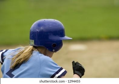Girl softball player running