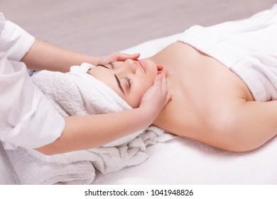 Girl in spa having face massage.