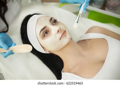 Girl At Spa Salon. Beautician Applying White Cosmetic Powder