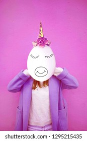 Girl with space instead of a face and egg head with unicorn decoration. Contemporary art collage. Kawaii face - unicorn with flower and eyes. Abstract surrealism and minimalism