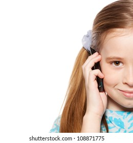 Girl, speaking on the phone. Child talking on mobile phone isolated on white background