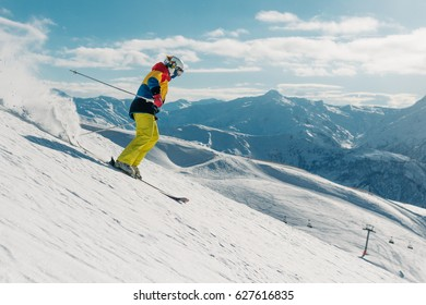 girl with special ski equipment is riding fast, jumping, freeriding very fast in the mountain forest