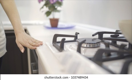 the girl spends her hand on the counter top in the kitchen. girl checks the quality of countertops