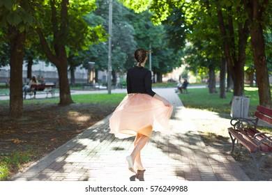 girl spinning in the sunlight skirt tutu park city summer sun