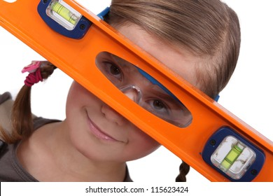 Girl with a spirit level