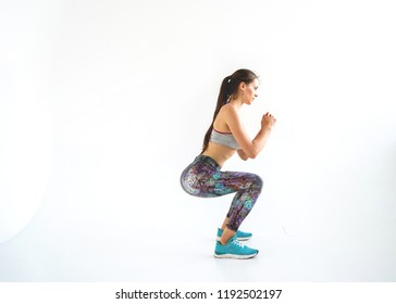 girl sportsman crossfit and squats against white background